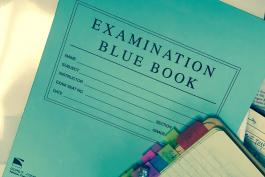 image of blue exam book and study materials