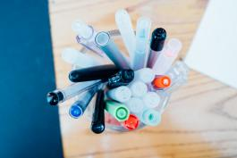 image of cup of different pens and markers