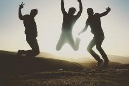 Happy guys jumping