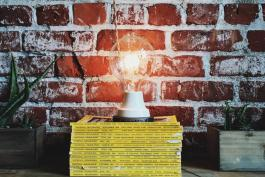 Lightbulb on stack of books