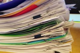 image of a stack of work seperated into paperclipped bundles