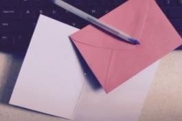 image of keyboard, pen, card, envelope